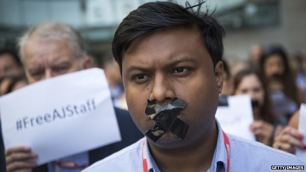 BBC staff and colleagues from other news organisations take part in a one-minute silent protest outside New Broadcasting House on 24 June 2014 in London, England
