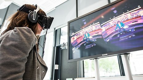 A person wearing an Oculus Rift headset to watch news