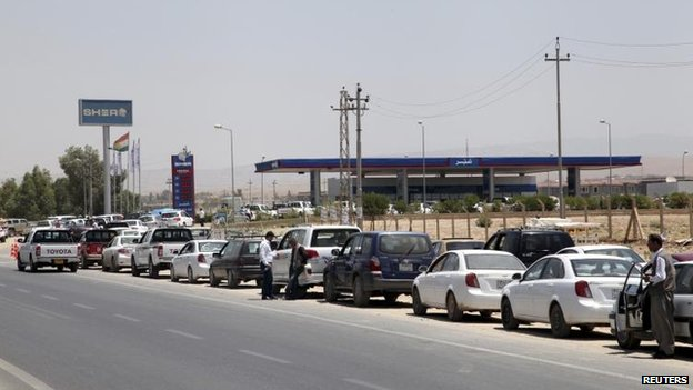 Cars queue for fuel in Irbil, 24 June