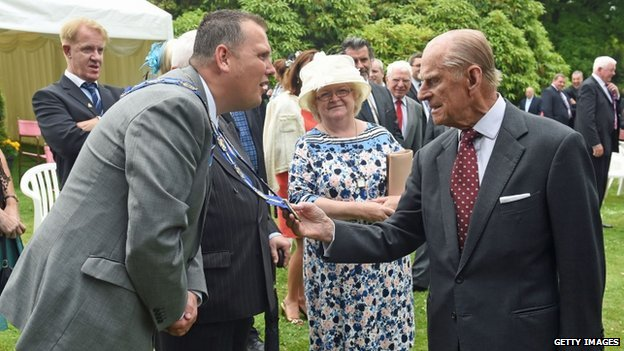 Prince Philip met the deputy mayor of Lisburn Andrew Ewing at the garden party