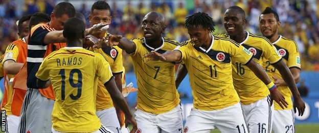 Colombia celebrate after Juan Cuadrado's penalty against Japan