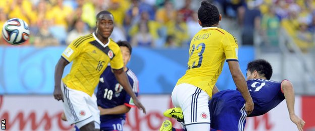 Japan forward Shinji Okazaki's heads in a goal for his side against Colombia