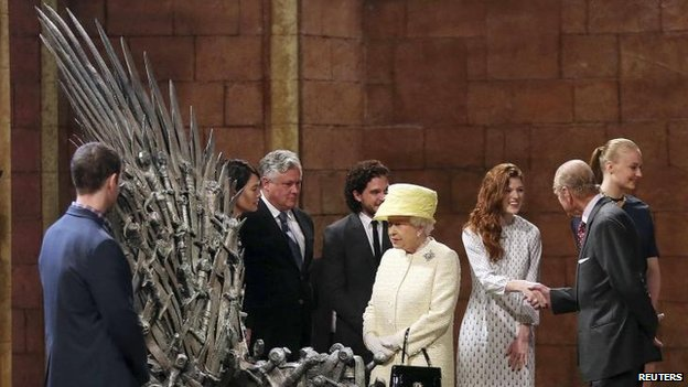 Queen looks at Iron Throne