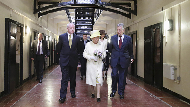 The Queen with Northern Ireland First Minister Peter Robinson, right, and Deputy First Minister Martin McGuinness on a visit to Belfast's Crumlin Road jail.