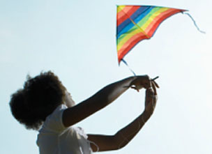 Generic image of a child flying a kite