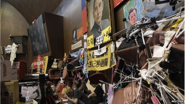 Protesters sit in front of a portrait of Sun Yat-sen during a sit-in at Taiwan's parliament, in Taipei on 7 April 2014