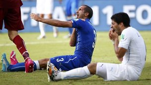 Italy's Giorgio Chiellini and Luis Suarez of Uruguay
