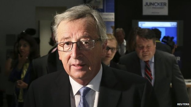 File photo: Jean-Claude Juncker of the European People's Party leaves the party's headquarters in Brussels, 26 May  2014