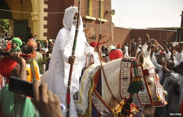 New emir of Kano Lamido Sanusi arrives at his palace on a horse in Kano city on 13 June 2014