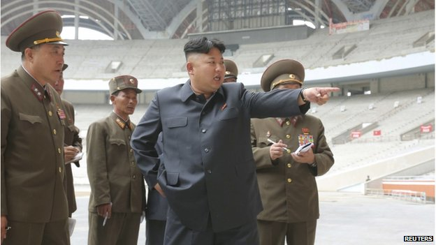 North Korean leader Kim Jong-un gives field guidance to the remodelling site of the May Day Stadium in this undated photo released by North Korea's Korean Central News Agency in Pyongyang on 20 June 2014.
