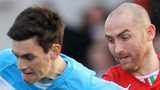 Ballymena United's Mark Surgenor in action against Barry Johnston of Cliftonville