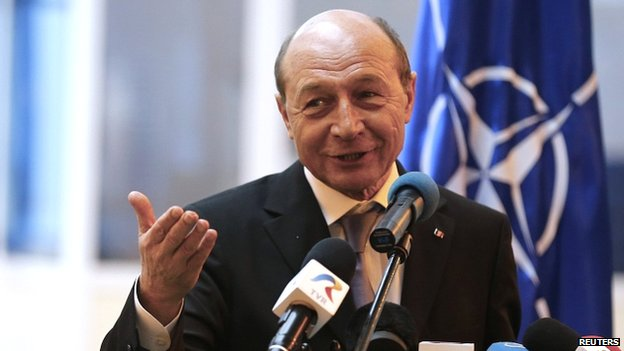 Romanian President Traian Basescu speaks to reporters after visiting the destroyer USS Donald Cook in the Black Sea port of Constanta on 14 April 2014