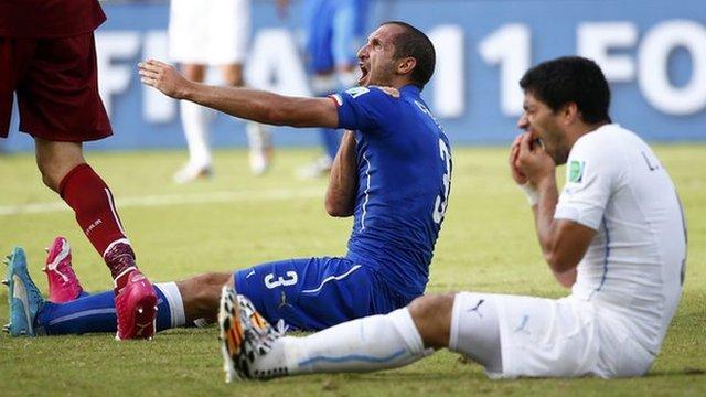 Italy's Giorgio Chiellini and Luis Suarez of Uruguay
