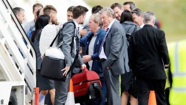 Roy Hodgson gets off the plane at Luton airport