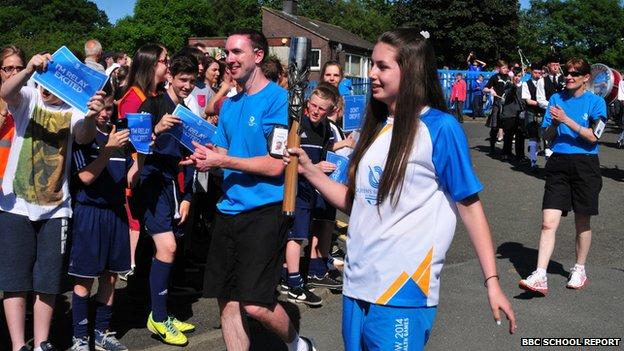 Newbattle student Abby carries the Queen's Baton