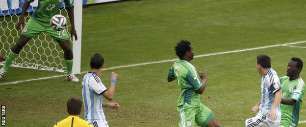 Argentina's Lionel Messi scores the first goal against Nigeria