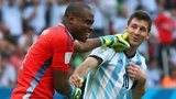 Goalkeeper Vincent Enyeama of Nigeria (left) shares a joke with Lionel Messi