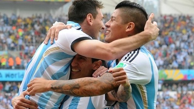 Argentina goalscorers Lionel Messi (left) and Marcos Rojo (right) celebrate with Angel Di Maria