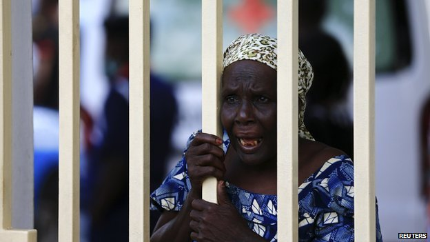 A woman reacts as injured victims arrive at the Maitama general hospital in Abuja on 25 June 2014.