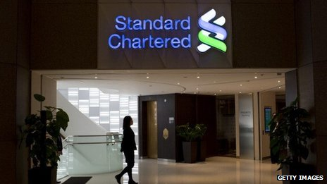 An employee walks through a Standard Chartered bank branch in Hong Kong,