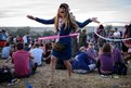 A festival goer uses a hula hoop at Glastonbury