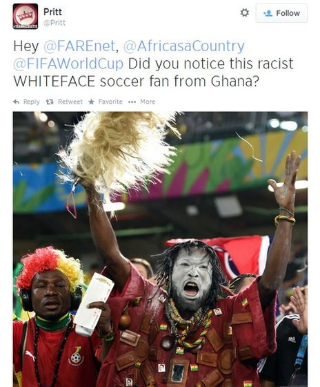 "A tweet showing an image of a black fan with white face paint on at the World Cup, and the words ""Hey @FARENET, @AfricasaCountry @FIFAWorldCup Did you notice this racist WHITEFACE soccer fan from Ghana?"