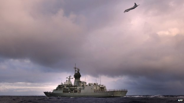 File photo: HMAS Perth transits through the southern Indian Ocean as an Orion P-3K of the Royal New Zealand Air Force searches for debris for missing Malaysia Airlines flight MH 370, 13 April 2014