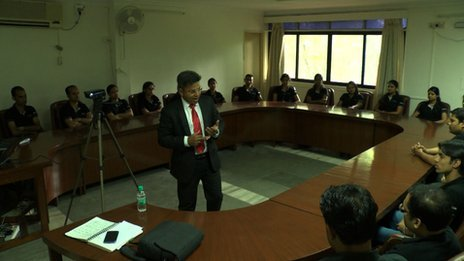 Sudheer Nair addressing a group of colleagues