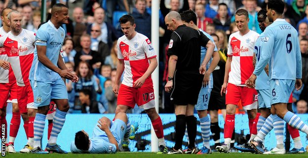 Joey Barton is sent off against Manchester City