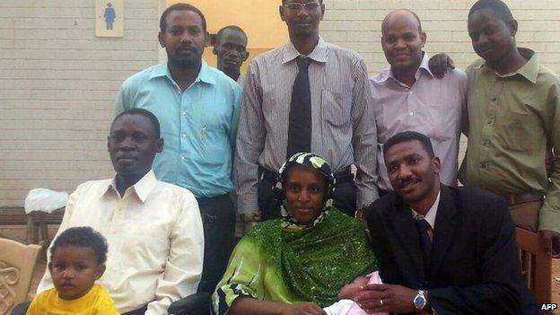 Meriam Ibrahim with her husband Daniel Wani, children and legal team in Khartoum on 23 June 2014