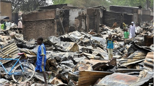 Shops burnt in a suspected Boko Haram attack in Gamboru Ngala district, Borno State, May 2014