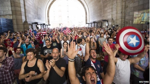 US soccer fans cheer at the start of the team's 2014 World Cup Group G soccer match against Germany at a viewing party under the Manhattan Bridge in New York 26 June 2014