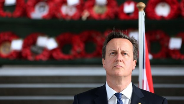 "UK Prime Minister David Cameron looks on as he attends a ""Last Post"" ceremony at the Menin Gate in Ypres, on 26 June 2014"