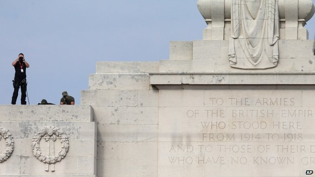 Snipers stand atop the Menin gate during a ceremony at an EU Summit meeting in Ypres, Belgium on 26 June 2014