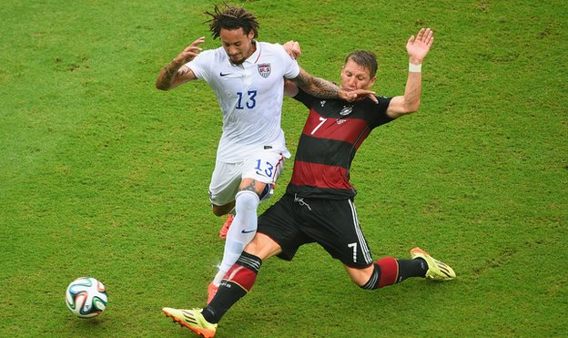 Jermaine Jones of the United States is challenged by Bastian Schweinsteiger of Germany during the 2014 FIFA World Cup