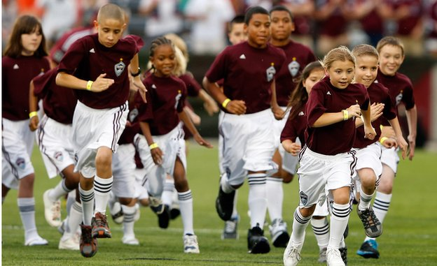 The Colorado Rapids youth soccer player escorts leave the field