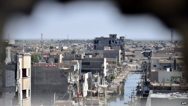 A picture taken through a hole in a wall on 24 June 2014 in the city of Ramadi in Anbar province