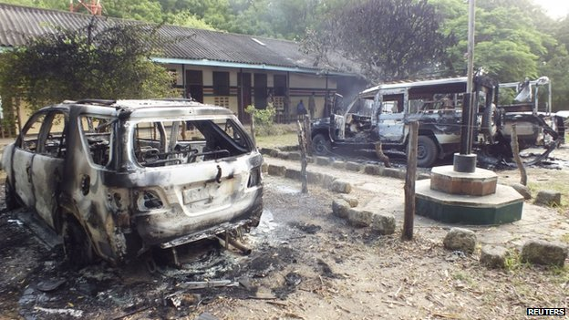 Wreckages of burnt cars are seen outside the Mpeketoni police station after unidentified gunmen attacked the coastal Kenyan town of Mpeketoni, 16 June 2014