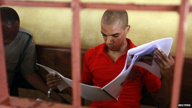 British terror suspect Jermaine John Grant reads a evidence report complied by the UK police officers at a court in Mombasa, Kenya - 20 June 2014