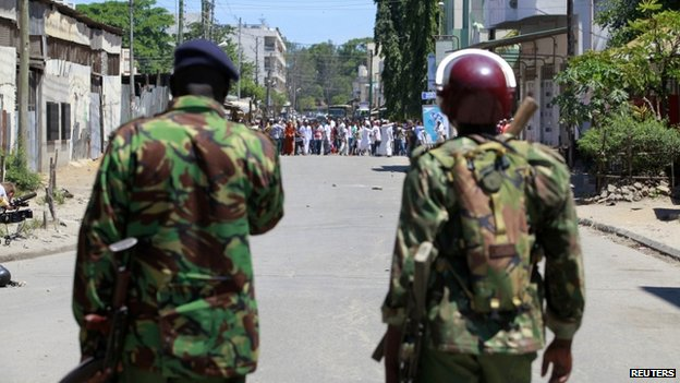 Riot police stand guard in Mombasa, Kenya, after Friday prayers - 4 April 2014