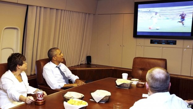 President Barack Obama watches the match from Air Force One