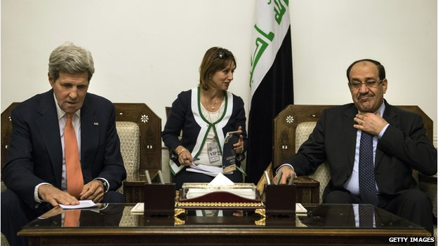 Iraqi Prime Minister Nouri Maliki (right) and US Secretary of State John Kerry meet at the prime minister's office in Baghdad on 23 June 2014.