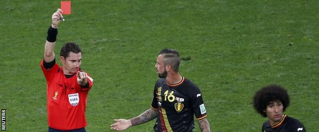Belgium midfielder Steven Defour (centre) is sent off during the game against South Korea