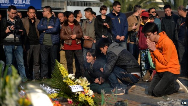 This picture taken on 7 March 2014 shows relatives mourning victims at the scene of the terror attack at the main train station in Kunming, southwest China's Yunnan province.