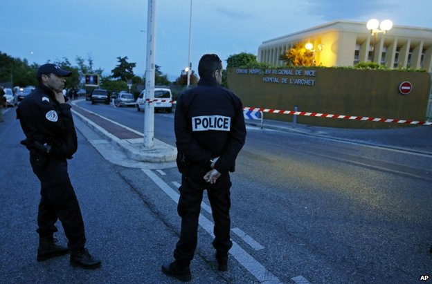 Police outside the hospital where Helene Pastor and her driver were shot in the French city of Nice, 6 May