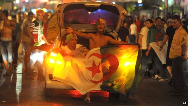 Algerian football fans celebrate in the streets of Algiers, Algeria