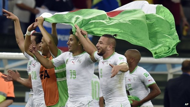 Algerian players celebrate after the group H World Cup football match between Algeria and Russia at the Arena da Baixada in Curitiba, Brazil - Thursday 26 June 2014