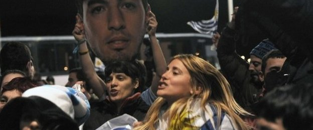 Fans wait for Luis Suarez at Carrasco International Airport near Montevideo