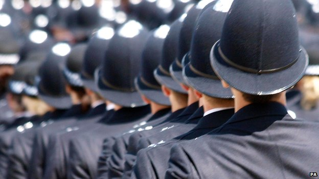 Police graduates at a passing out ceremony