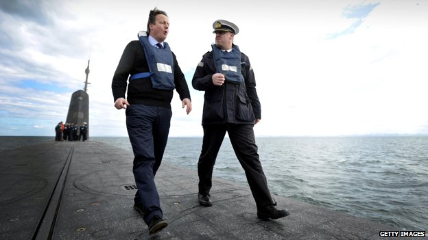David Cameron with Commander John Livesey aboard HMS Vanguard, 2013